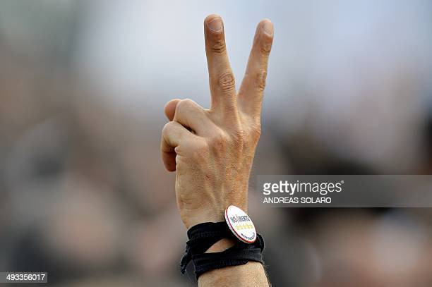 A supporter of 5Star Movement shows the V sign during a M5S rally in support of the party's candidates for the upcoming European elections on May 23...