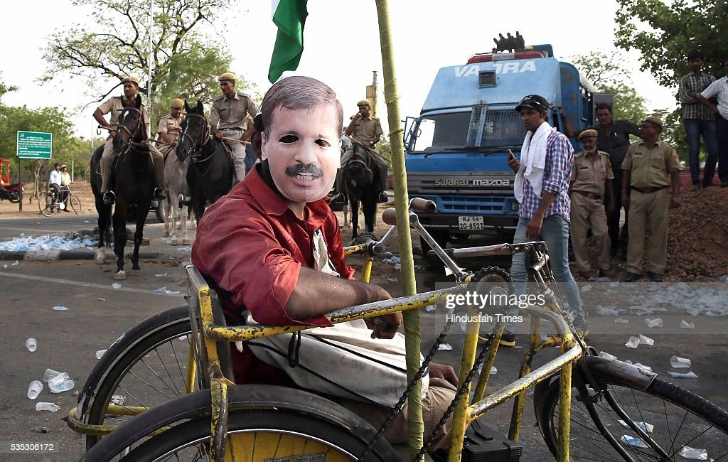 A supporter of Aam Aadmi Party (AAP) in a rally to submit a memorandum to CM Vasundhara Raje for prohibition of liquor in state, being stopped by the police officials, on May 29, 2016 in Jaipur, India.