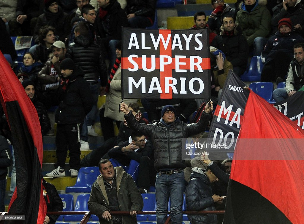 Supporter of AC Milan holds up a banner showing his support of new signing Mario Balotelli during the Serie A match between AC Milan and Udinese Calcio at San Siro Stadium on February 3, 2013 in Milan, Italy.