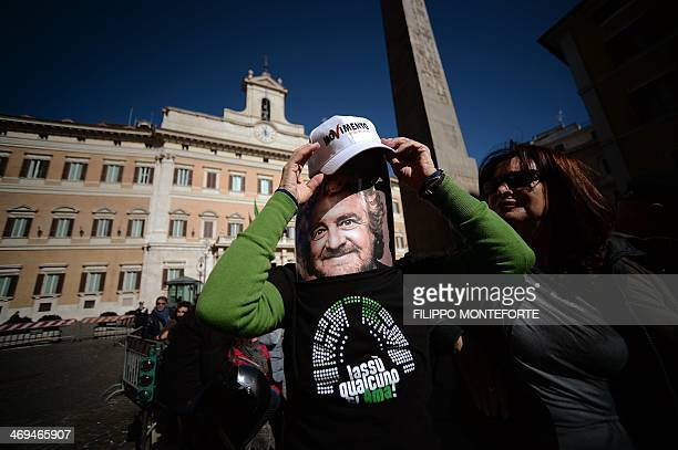 A supporter of antiestablishment party Five Star movement demontrate wearing a mask of its party leader Beppe Grillo in front of the Montecitorio...