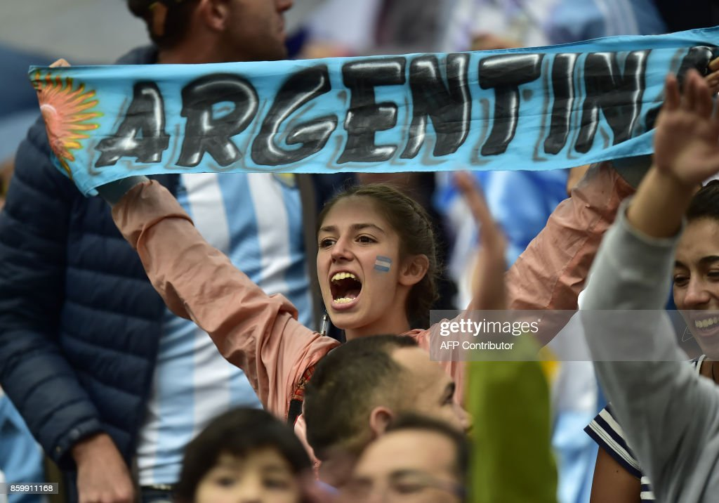 A supporter of Argentina cheers as she waits for the start of the 2018 World Cup qualifier football match against Ecuador in Quito, on October 10, 2017. / AFP PHOTO / Rodrigo BUENDIA