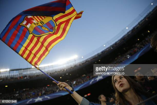 A supporter of Barcelona football team waves a club flag before the UEFA Champions League quarterfinal second leg football match FC Barcelona vs...