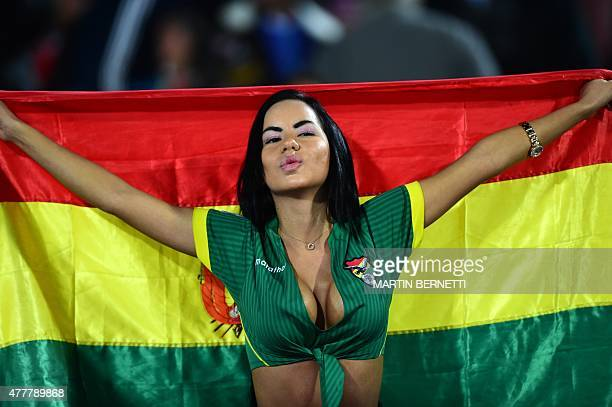 A supporter of Bolivia waits for the start of the 2015 Copa America football championship match between Bolivia and Chile in Santiago on June 19 2015...