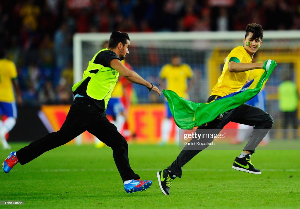 A supporter of Brazil runs over the pitch after the international friendly match between Switzerland and Brazil at St. Jakob Stadium on August 14, 2013 in Basel, Switzerland.