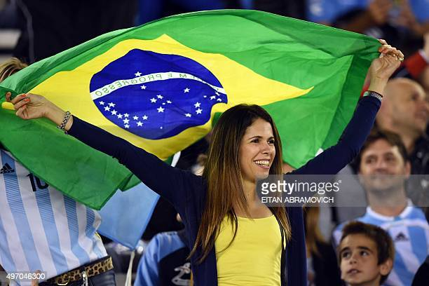 A supporter of Brazil waits for the start of the Russia 2018 FIFA World Cup South American Qualifiers football match between Argentina and Brazil in...