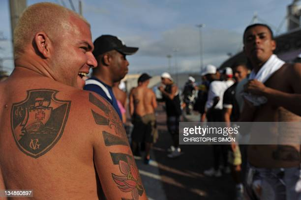 A supporter of Brazil's Vasco da Gama shows his tatooes outside the Joao Havelange stadium before the derby against Flamengo for the Brazilian...