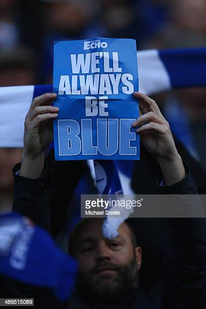 A supporter of Cardiff City shows his support for the old kit colours of blue and white during the Barclays Premier League match between Cardiff City...