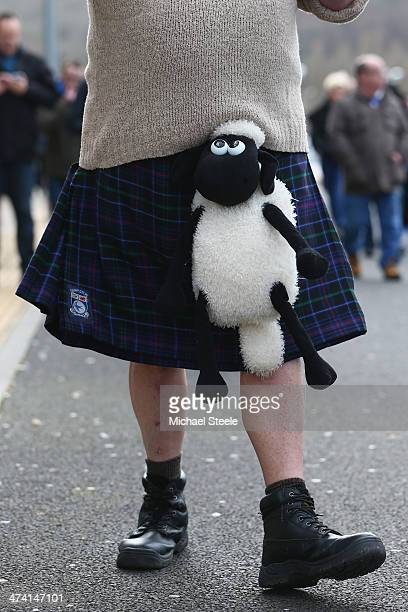 A supporter of Cardiff City wearing a kilt and cuddly sheep outside the stadium ahead of the Barclays Premier League match between Cardiff City and...