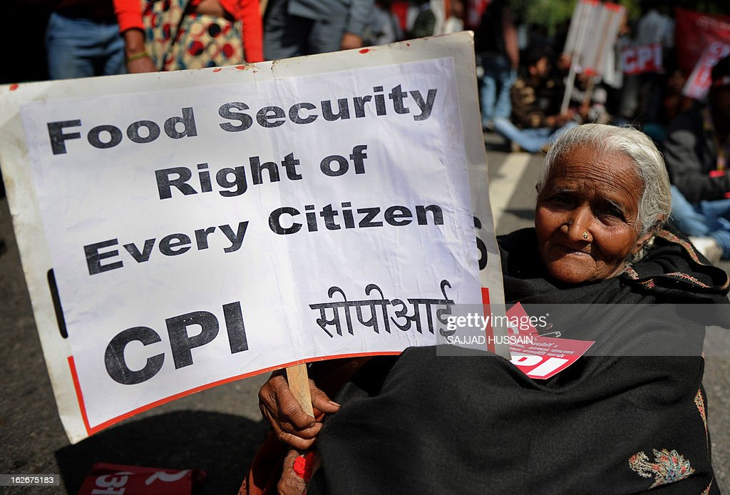 A supporter of Communist Party of India(Marxists) holds a placard during a protest demanding food security in New Delhi on February 26, 2013. Protestors demanded a universal public distribution system, a check on hoarding and black-marketing, an end to future trading and the passage of a food security bill with appropriate amendments to ensure ration to all citizens.