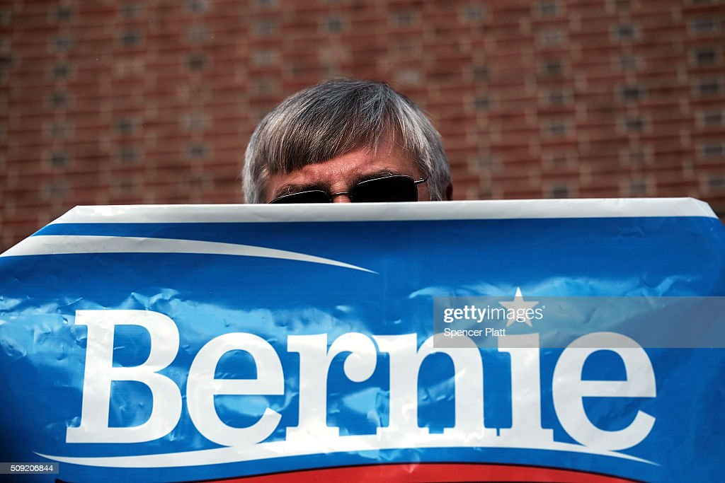 A supporter of Democratic presidential candidate Bernie Sanders waits for his arrival into downtown Concord on Primary Day on February 9, 2016 in Concord, New Hampshire. Sanders, who is expected to win over Democratic rival Hillary Clinton, greeted voters before taking a short walk where he was mobbed by members of the media.