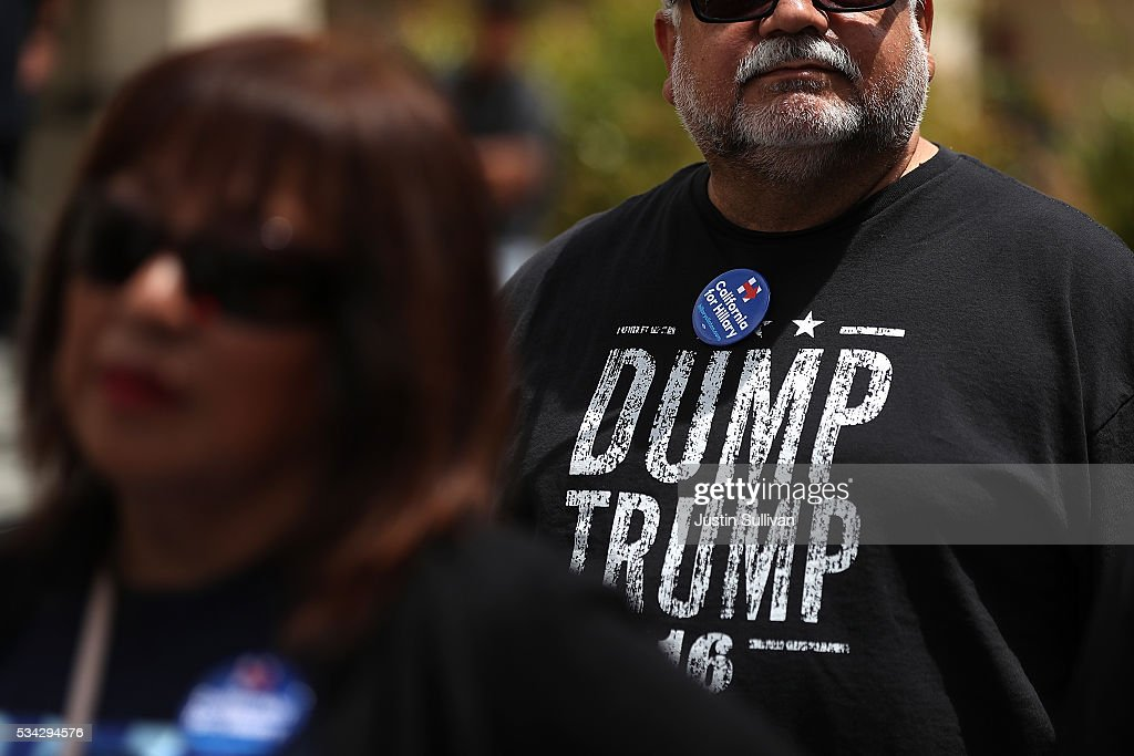 A supporter of democratic presidential candidate former Secretary of State Hillary Clinton wears a 'Dump Trump' shirt before a campaign rally at Harrell College on May 25, 2016 in Riverside, California. Hillary Clinton is campaigning in California ahaed of the State's presidential primary on June 7th.