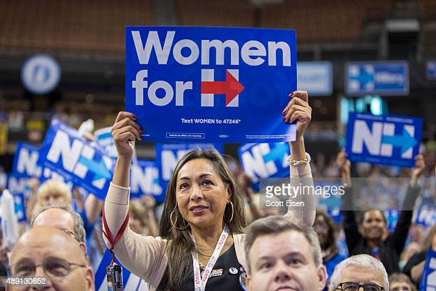 A supporter of democratic presidential candidate Hillary Clinton holds up a sign while Clinton speaks on stage during the New Hampshire Democratic...