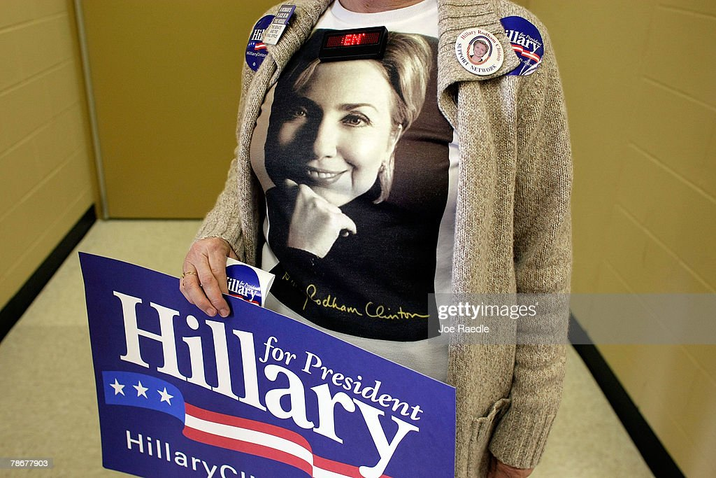 A supporter of Democratic presidential candidate Sen. Hillary Clinton (D-NY) waits for her to speak during a campaign stop December 30, 2007 in Vinton, Iowa. With the Iowa caucuses less than a week away the race has tightened in both Iowa and New Hampshire.