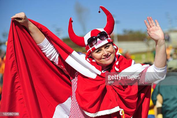 A supporter of Denmark waves prior to the start of the South Africa 2010 World Cup football match between The Netherlands and Denmark on June 14 2010...