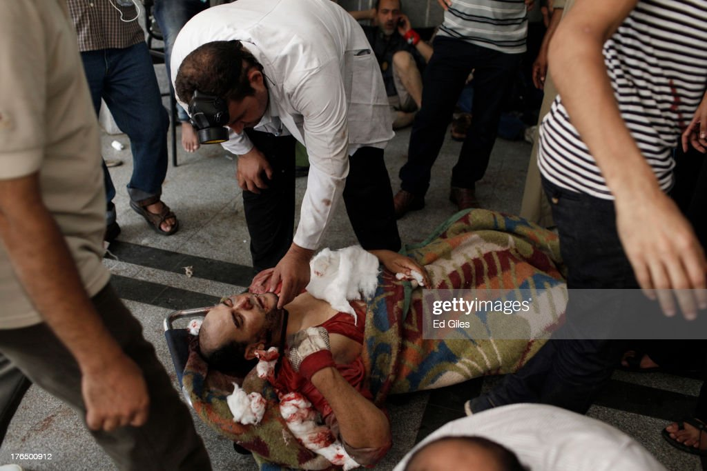 A supporter of deposed Egyptian President Mohammed Morsi lies wounded on the floor of the Rabaa al-Adaweya Medical Centre in the Nasr City district on August 14, 2013 in Cairo, Egypt. An unknown number of pro-Morsi protesters were killed in Egypt's capital today as Egyptian Security Forces undertook a planned operation to clear Morsi supporters from two sit-in demonstrations in Cairo where they have camped for over one month. Egyptian Police and Army forces entered protest sites in the Nasr City and Giza districts at dawn using tear gas, live fire and bulldozers to disperse protesters and destroy the camps. A state of emergency has been declared in Egypt to begin this afternoon and will reportedly last for one month.