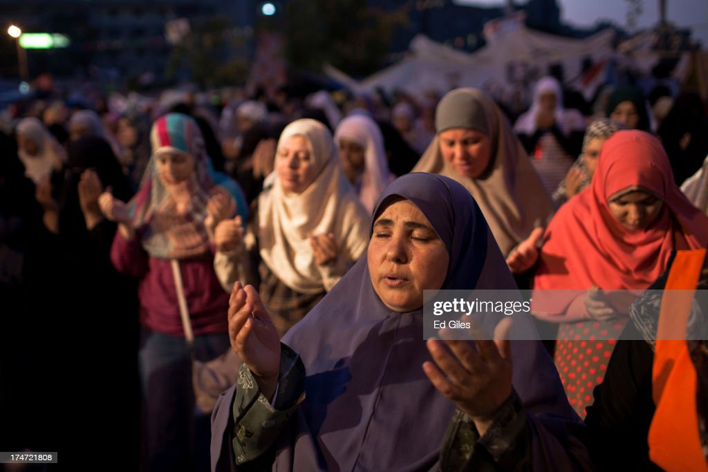 A supporter of deposed Egyptian President Mohammed Morsi prays prior to the 'iftar' fastbreaking meal at a sitin protest at the Rabaa al Adweya...