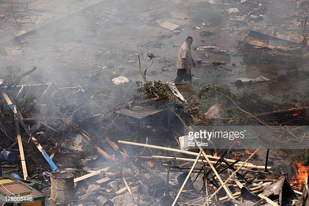 A supporter of deposed Egyptian President Mohammed Morsi stands amongst debris during a violent crackdown by Egyptian Security Forces on a proMorsi...
