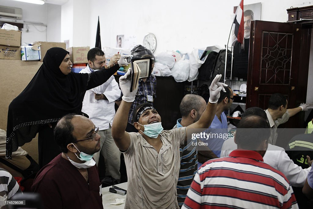 A supporter of deposed Egyptian President Mohammed Morsi yells inside a field hospital where bodies of supporters of Morsi are brought after reportedly being killed in fighting between pro-Morsi demonstrators and Egyptian security forces overnight, near the Rabaa al Adweya Mosque in the district of Nasr on July 27, 2013 in Cairo, Egypt. Morsi supporters had gathered at a sit in protest in Nasr City on Friday to continue demonstrations against the overthrow of Morsi, Egypt's first democratically elected leader, on July 3 by the Egyptian Armed Forces. Muslim Brotherhood leaders had called for pro-Morsi protesters to return to the streets on Friday in response to a speech made Wednesday by the Chief of Egypt's Armed Forces, General Abdel Fattah al-Sissi, who called for mass pro-military protests across Egypt on Friday against 'violence and terrorism' and in support of the military's overthrow of Morsi.