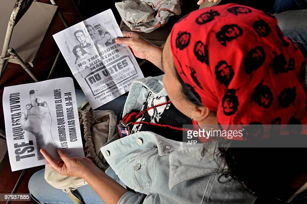 A supporter of deposed Honduran President Manuel Zelaya Rosales wearing a headscarf with the image of Argentineborn revolutionary leader Ernesto...