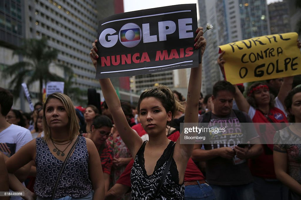 A supporter of Dilma Rousseff Brazil's president not pictured holds a banner reading 'Coup Never More' during a demonstration in Rio de Janeiro...
