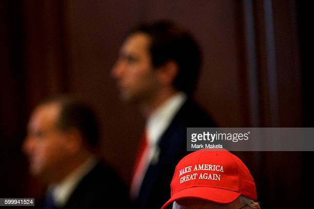 A supporter of Donald J Trump wears a 'Make America Great Again' hat before the Republican Presidential nominee delivered a speech at The Union...