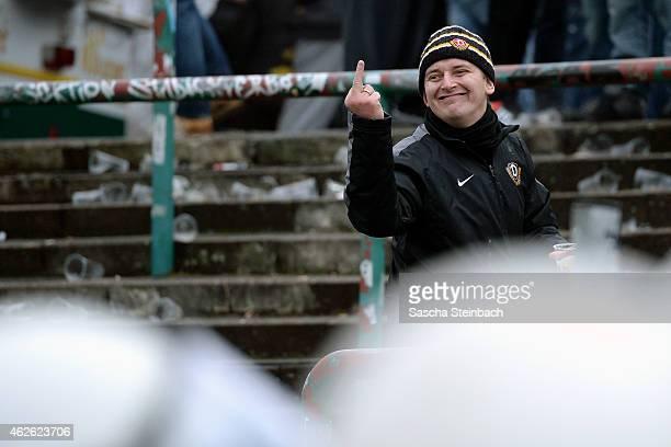 A supporter of Dresden gestures towards the police during the 3 Liga match between Preussen Muenster and Dynamo Dresden at Preussenstadion on...