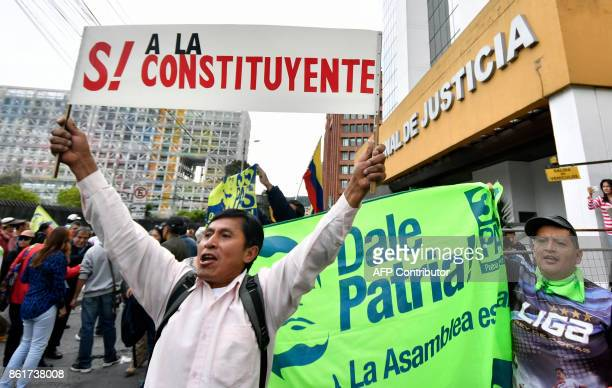 A supporter of Ecuadorean Vice President Jorge Glas holds a banner reading 'Yes to the constituent ' during a demonstration outside the National...