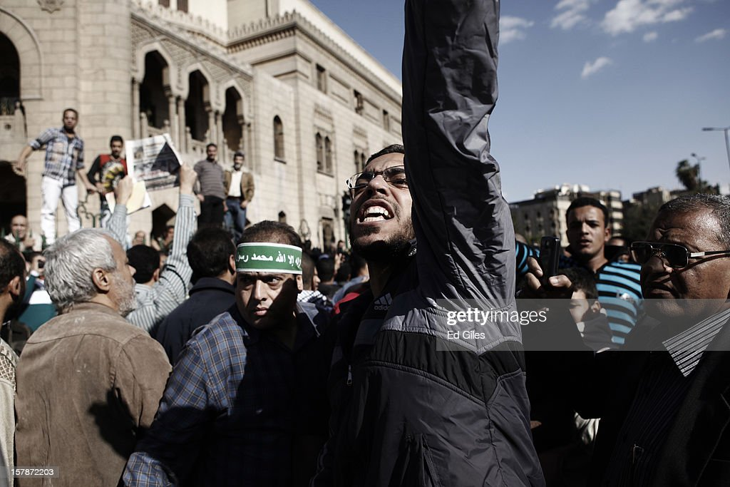A supporter of Egyptian President Mohammed Morsi chants during a funeral service for three Muslim Brotherhood members, killed in clashes with anti-Morsi demonstrators two nights previously, at Al Azhar Mosque on December 7, 2012, in Cairo, Egypt. A funeral service for three members of the Muslim Brotherhood was held during Friday prayers in Cairo before the bodies were carried to a nearby cemetery for burial. Supporters of President Morsi and anti-Morsi protesters continue to hold opposing demonstrations across Egypt, as tensions in the country remain high after a draft constitution was rushed through the country's parliament overnight on November 29. The country's new draft constitution, passed by a constitutional assembly dominated by Islamists, will go to a referendum on December 15. (Photo by Ed Giles/Getty Images).
