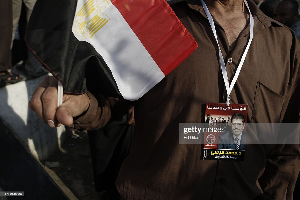 A supporter of Egyptian President Mohammed Morsi wears a pendant showing Morsi during a demonstration at the Rabaa al Adawiya Mosque in the suburb of Nasr City on July 2, 2013 in Cairo, Egypt. In a statement on July 1, the Egyptian Army asked Egyptian President Mohammed Morsi to resolve mass demonstrations against his continued rule or face intervention by the military within 48 hours. Crowds of pro- and anti-government protesters gathered in locations across Egypt on June 30, the day of a series of nation-wide mass demonstrations entitled 'Tamarod', or 'Rebel'. The 'Tamarod' campaign, organised by a coalition of opposition political groups and planned to take place on the first anniversary of Egyptian President Mohammed Morsi's election to the country's Presidency, aims to bring down the government of President Morsi through country-wide demonstrations.