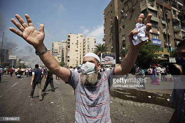 A supporter of Egypt's ousted president Mohamed Morsi gestures during clashes with riot police on a street leading to Rabaa alAdawiya square in Cairo...