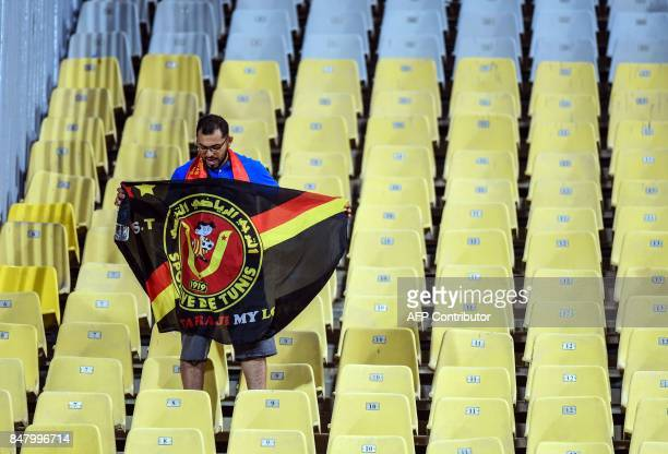 A supporter of Esperance of Tunis attends the CAF Champions League quarterfinal firstleg football match between Egypt's AlAhly and Tunisia's...