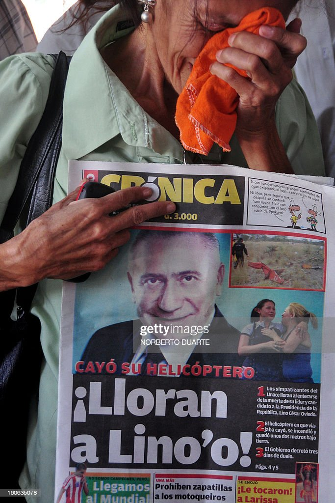 A supporter of former Paraguayan general and UNACE party presidential candidate Lino Oviedo --who died along with his bodyguard Denis Galeano and pilot Ramon Picco Delmas in a helicopter crash on February 2-- cries at the party's headquarters in Asuncion on February 4, 2013. Oviedo, 69, the controversial presidential candidate who helped topple Paraguayan dictator Alfredo Stroessner in 1989, died when the aircraft crashed en route to Asuncion while returning from a campaign rally in northern Paraguay, prompting claims of foul play. AFP PHOTO/Norberto DUARTE