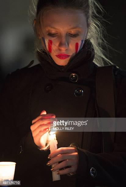 A supporter of France takes part in a candle light vigil at Lafayette Square November 14 2015 in Washington DC one day after the terrorist attacks in...