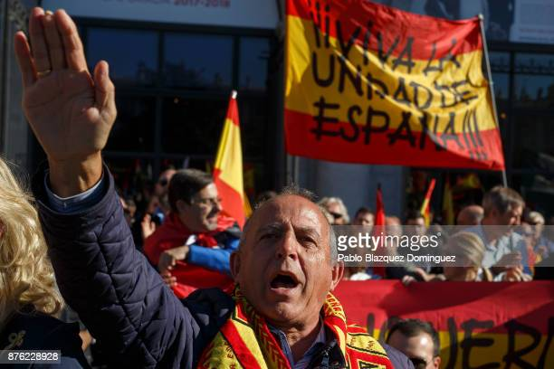 A supporter of Franco does a fascist salute as others hold a banner reading 'For the Unity of Spain' during a rally commemorating the 42nd...