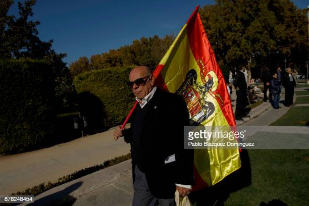 A supporter of Franco holds a preconstitutional Spanish flag during a rally commemorating the 42nd anniversary of Spain's former dictator General...