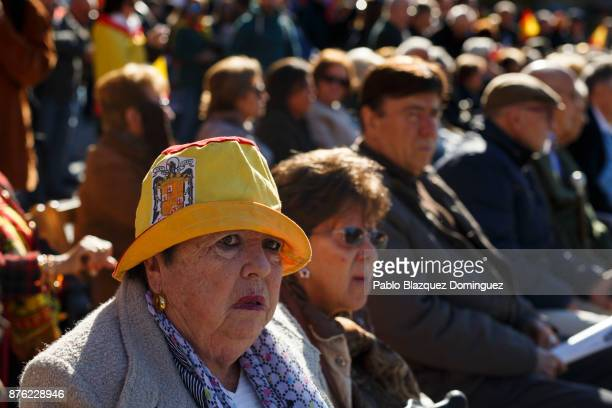 A supporter of Franco wears a hat with a preconstitutional Spanish flag during a rally commemorating the 42nd anniversary of Spain's former dictator...