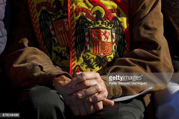 A supporter of Franco wears a scarf with a preconstitutional Spanish flag during a rally commemorating the 42nd anniversary of Spain's former...