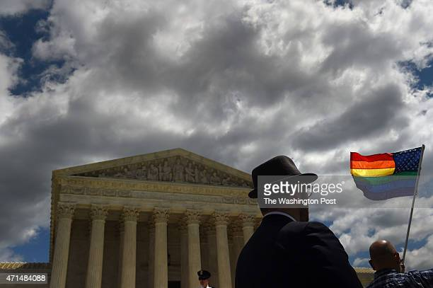 A supporter of gay marriage waves his rainbow flag in front of the US Supreme Court in Washington DC April 28 where cases are heard about the...