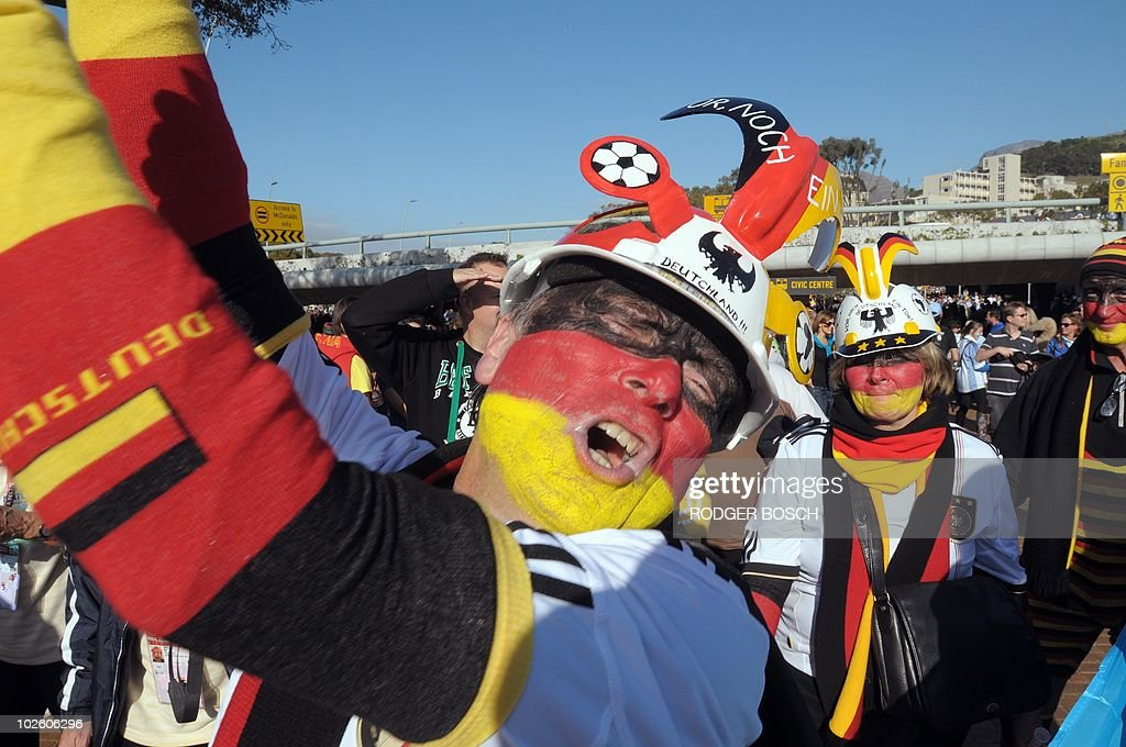 A supporter of Germany wearing a makarapa cheers as he arrives for the 2010 World Cup quarterfinal football match Argentina vs Germany on July 3 2010...