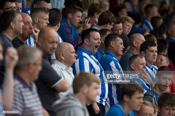 A supporter of Hartlepool United yawning during the firsthalf at the Victoria Ground Hartlepool during a preseason friendly between the home team and...