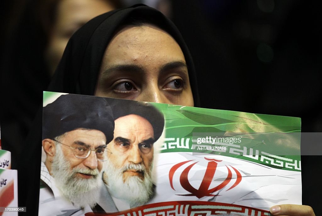 A supporter of Iranian advisor to the supreme leader Ayatollah Ali Khamenei and hopeful conservative presidential candidate, Ali Akbar Velayati attends his campaign rally in Tehran, on June 12, 2013.
