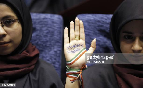 TOPSHOT A supporter of Iranian conservative presidential candidate and Tehran mayor Mohammad Bagher Ghalibaf attends a campaign rally in the Iranian...