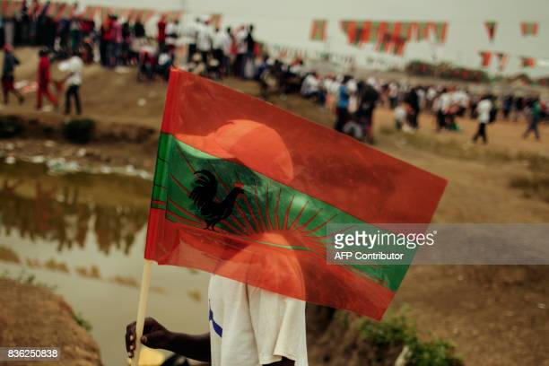 A supporter of Isaias Samakuva presidential candidate for Angola's main opposition National Union for the Total Independence of Angola holds an UNITA...