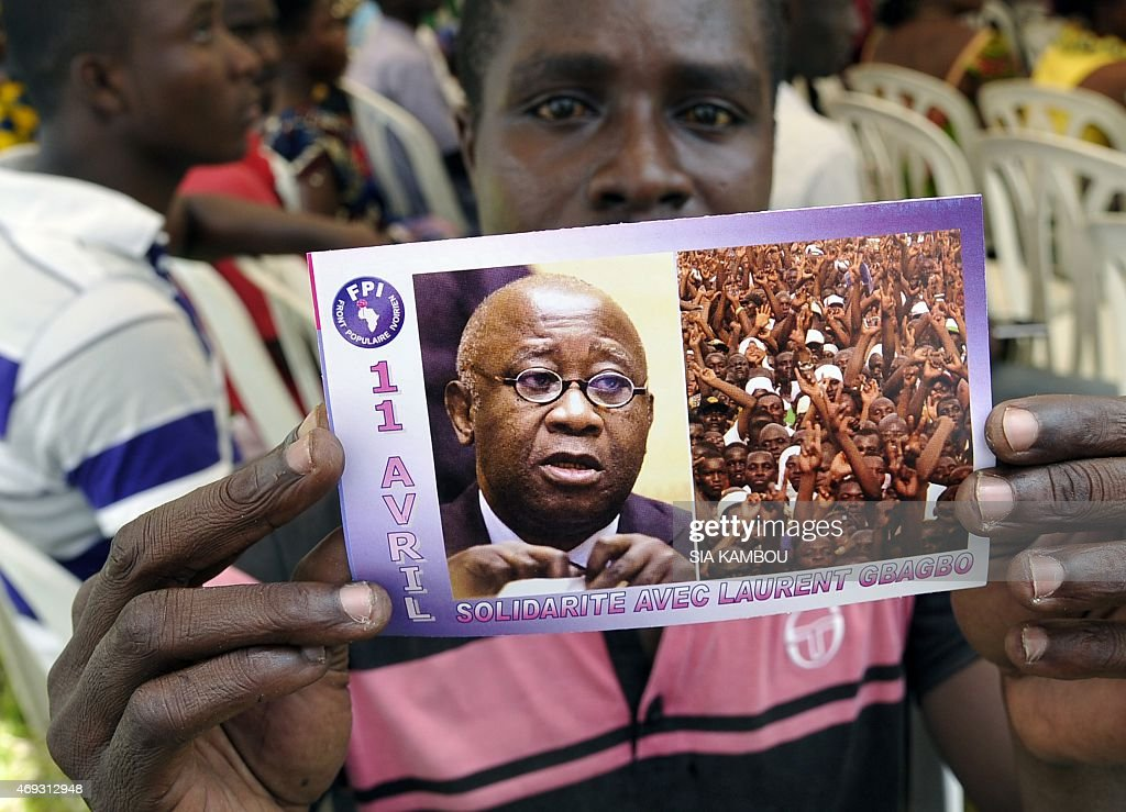 A supporter of Ivory Coast's former president <a gi-track='captionPersonalityLinkClicked' href=/galleries/search?phrase=Laurent+Gbagbo&family=editorial&specificpeople=239000 ng-click='$event.stopPropagation()'>Laurent Gbagbo</a> holds a flyer picturing Gbagbo and reading in French 'April 11 Solidarity with <a gi-track='captionPersonalityLinkClicked' href=/galleries/search?phrase=Laurent+Gbagbo&family=editorial&specificpeople=239000 ng-click='$event.stopPropagation()'>Laurent Gbagbo</a>' during a demonstration on April 11, 2015 in Abidjan on the anniversary of Gbagbo's arrest by the International Criminal Court of The Hague, on charges of crimes against humanity after post-election violence in 2011.