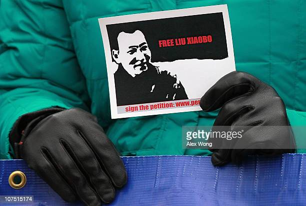 A supporter of jailed Chinese dissident and Nobel Prize laureate Liu Xiaobo holds a picture during a rally for Liu December 10 2010 in DC Liu was...