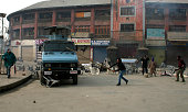 A supporter of Jammu and Kashmir Liberation Front strikes a Indian paramilitary vehicle during a demonstration on December 24 2014 in Srinagar the...