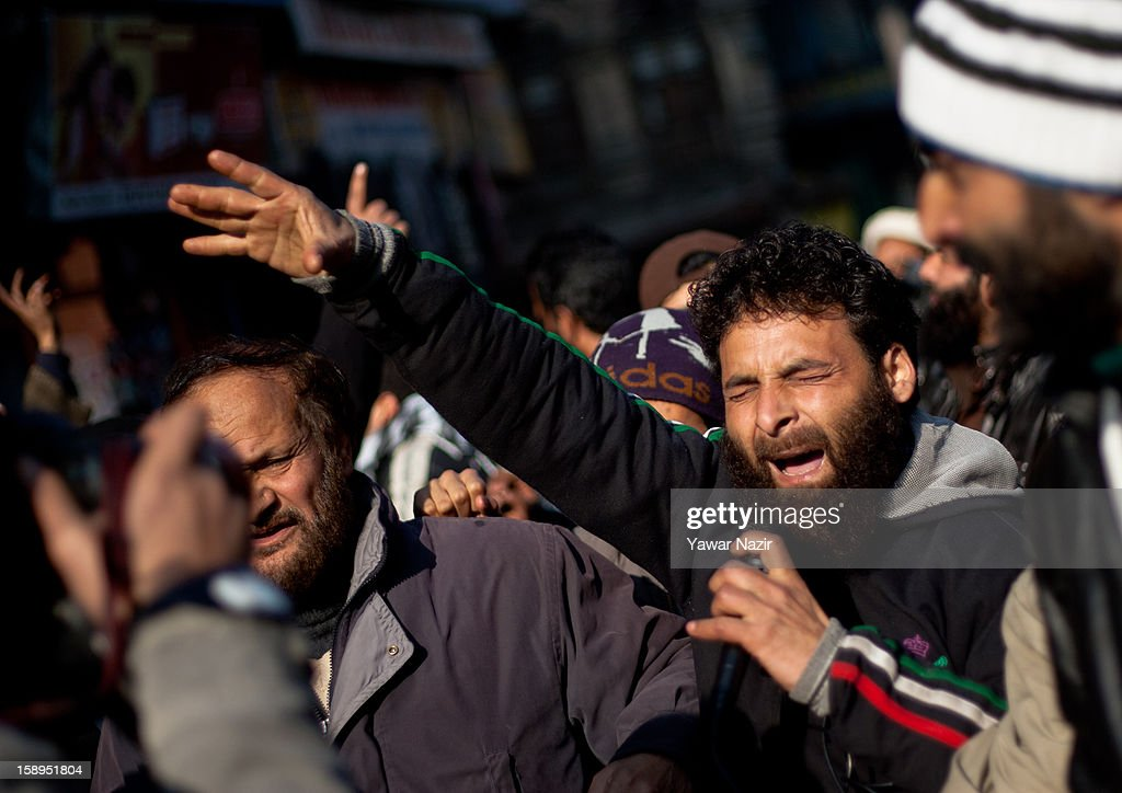 A supporter of Jammu and Kashmir Libration Front (JKLF), a separatist party fighting politically from Indian and Pakistan for complete Independence of Kashmir, shouts anti-Indian and pro-Kashmir slogans during a protest on January 04, 2013 in Srinagar, the summer capital of Indian-administered Kashmir, India. JKLF chairman Yasin Malik along with activists and supporters were detained after the group kick-started its 10-day 'jail bharo' to protest against awarding death and life sentences to Kashmiri prisoners by various Indian courts.