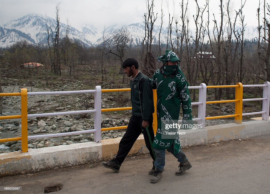 A supporter of Kashmir's main opposition political party, Peoples Democratic Party's (PDP) leader Mehbooba Mufti, and candidate for South Kashmir wears flags as he walks to listen to her speech during her road show on April 15, 2014, in Tsimer about 90 km south of Srinagar, the summer capital of Indian administered Kashmir, India.Kashmir's main opposition political party, Peoples Democratic Party's (PDP) leader Mehbooba Mufti, and candidate for South Kashmir started off with road shows across 21 villages as a part of her election campaign for the upcoming Lok Sabha polls on Tuesday. She started from Pahloo of the Noorabad constituency.