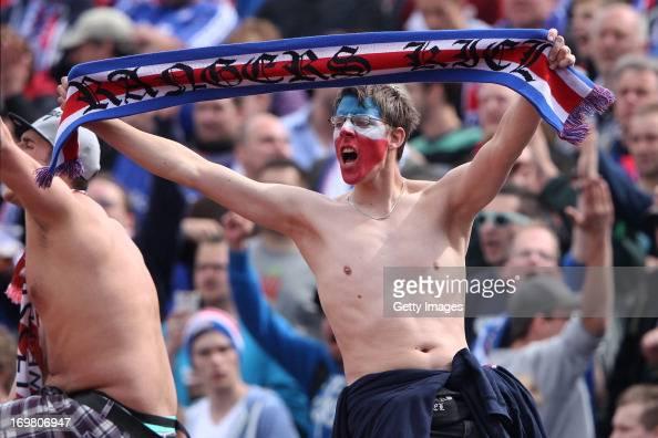 A supporter of Kiel reacts during the Regionalliga Playoff Second Leg match between Hessen Kassel and Holstein Kiel at Auestadion on June 2 2013 in...
