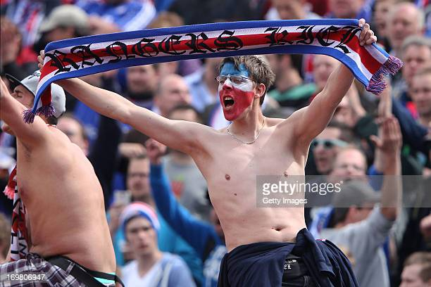 A supporter of Kiel reacts during the Regionalliga Playoff Second Leg match between Hessen Kassel and Holstein Kiel at Auestadion on June 2 2013 in...